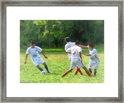 Soccer Ball In Play Framed Print by Susan Savad