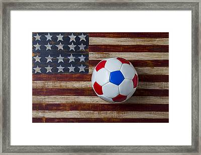 Soccer Ball On American Flag Framed Print by Garry Gay
