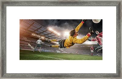 Soccer Goalie In Mid Air Save Framed Print by Peepo
