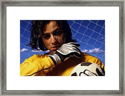 Soccer Goalkeeper In Net Framed Print by Don Hammond