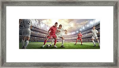 Soccer Player Tackling Ball In Stadium Framed Print by Dmytro Aksonov