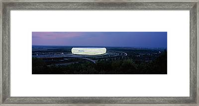 Soccer Stadium Lit Up At Nigh, Allianz Framed Print by Panoramic Images