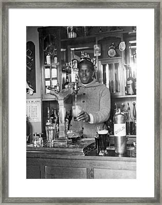 Soccer Star Pours Beer Framed Print by Underwood Archives