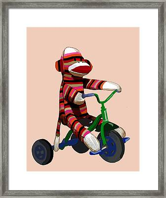 Sock Monkey And Tricycle Framed Print by Kelly McLaughlan