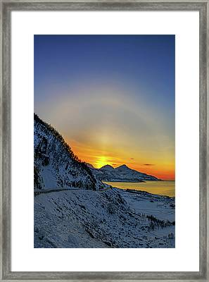 Solar Halo And Sun Pillar At Sunset Framed Print by Babak Tafreshi