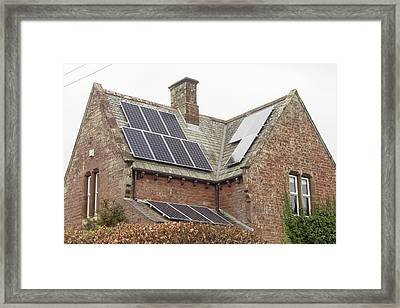 Solar Panels On A House Framed Print by Ashley Cooper