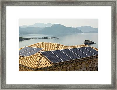 Solar Panels On A House Roof In Sivota Framed Print by Ashley Cooper