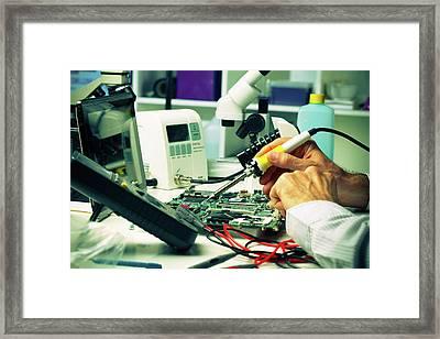 Soldering Micro Chip Framed Print