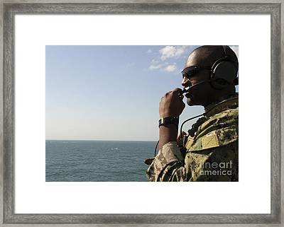 Soldier Instructs Small Boat Maneuvers Framed Print by Stocktrek Images