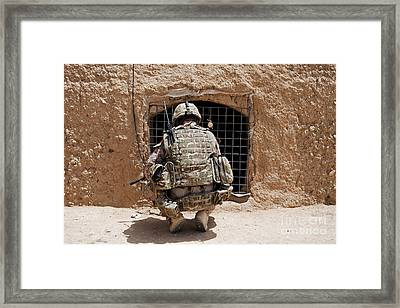 Soldier Searches A Compound Framed Print by Stocktrek Images