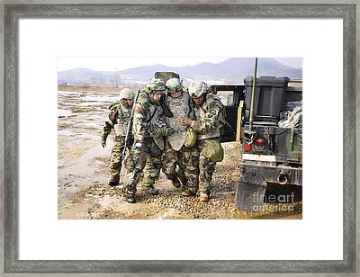 Soldiers Conduct Medical Evacuation Framed Print by Stocktrek Images