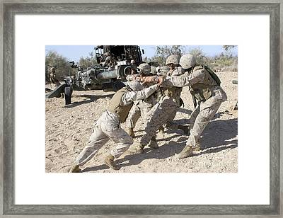 Soldiers Move The Muzzle-end Of A M777 Framed Print by Stocktrek Images