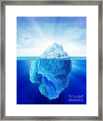 Solitary Iceberg In The Sea Framed Print by Leonello Calvetti