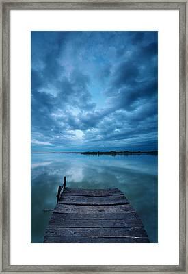 Solitary Pier Framed Print