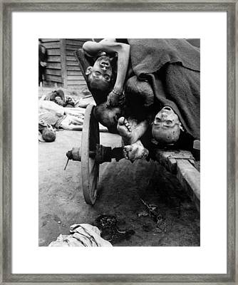 Some Of The Dead Slave Laborers Framed Print