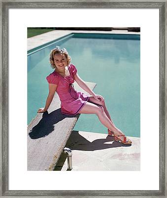 Sonja Henie Sitting On The Diving Board Framed Print by Artist Unknown