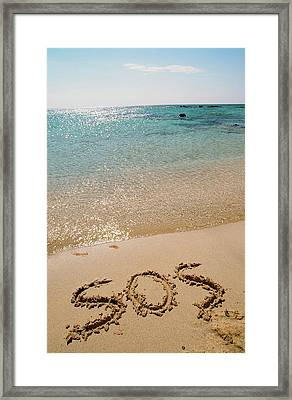 Sos Written On A Deserted Beach Framed Print by Ashley Cooper