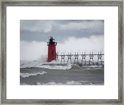 South Haven Pier Light In A Storm Framed Print