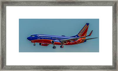 Southwest 737 Landing Framed Print by Paul Freidlund