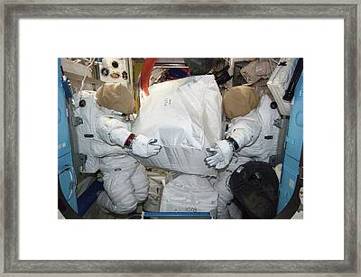 Spacesuits On The Iss Framed Print