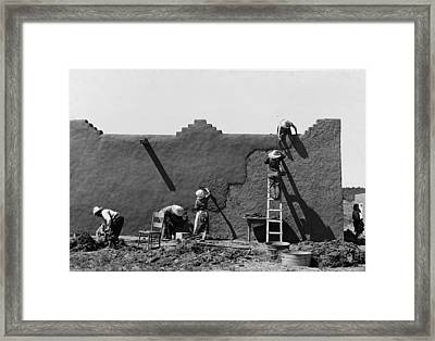 Spanish American Women Replastering An Adobe House Framed Print by Historic Photos