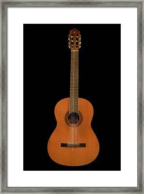 Spanish Guitar On Black Framed Print by Debra and Dave Vanderlaan