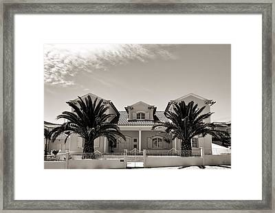 Spanish Village With Palm Trees Framed Print