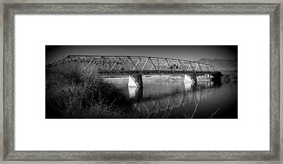 Spanning The Missouri  Framed Print by Roxann Tempel