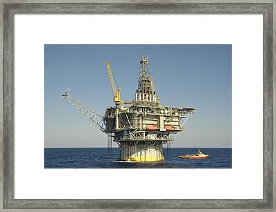 Spar Type Oil Rig With Flare And Boat Framed Print by Bradford Martin