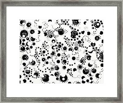 Speck Framed Print