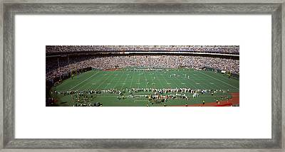 Spectator Watching A Football Match Framed Print by Panoramic Images