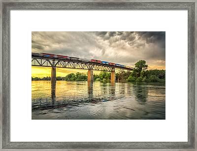 Speeding Reflections Framed Print by Randy Wood