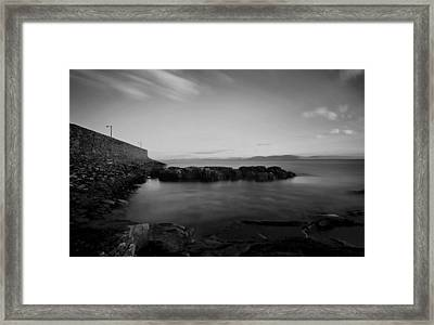 Spiddal Pier Framed Print by Peter Skelton
