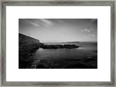 Spiddal Pier Framed Print by Peter Skelton