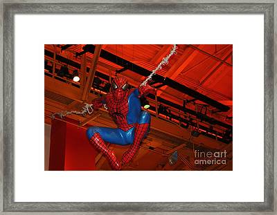 Spiderman Swinging Through The Air Framed Print