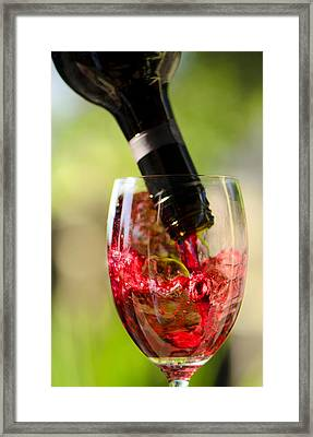 Spill The Wine  Framed Print by Damian Morphou