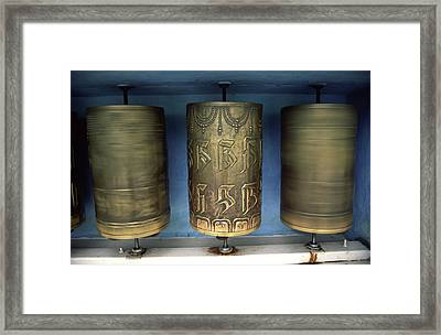 Spinning Prayer Wheels Is Said To Send Framed Print by Paul Dymond