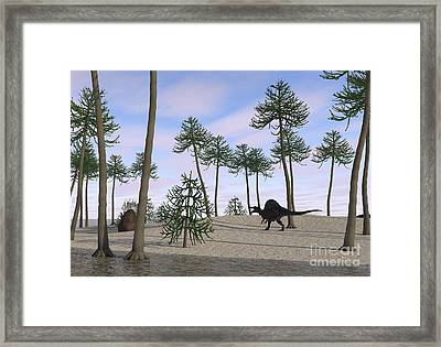 Spinosaurus Hunting Along The Shore Framed Print by Kostyantyn Ivanyshen