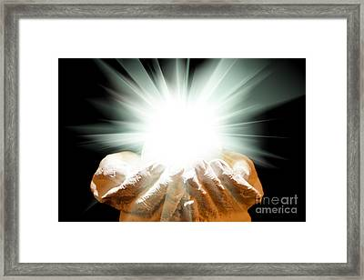 Spiritual Light In Cupped Hands On A Black Background Framed Print