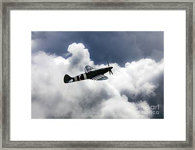 Spitfire Cloudy Skies  Framed Print by J Biggadike