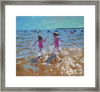 Splashing In The Sea Framed Print by Andrew Macara