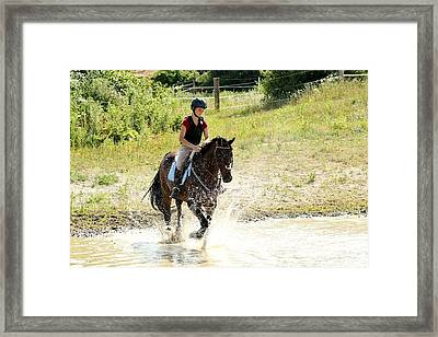 Splashing Thru Water Jump Framed Print