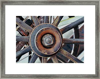 Spokes And Hub Framed Print by Kae Cheatham
