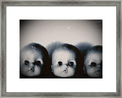 Spooky Doll Heads Framed Print