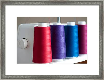Spools Of Thread Framed Print by Jim Corwin