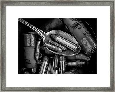 Spoonful Of Bullets Framed Print