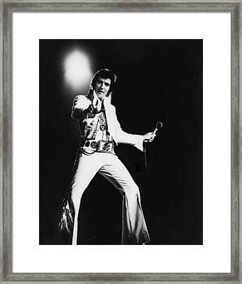 Spotlight Behind Elvis Presley Framed Print by Retro Images Archive