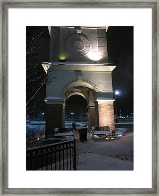 Spotlight On A Mall Tower Framed Print by Guy Ricketts