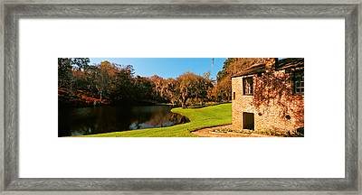 Springhouse And Chapel In A Garden Framed Print