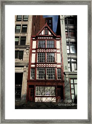 Squeezed In Framed Print by John Rizzuto